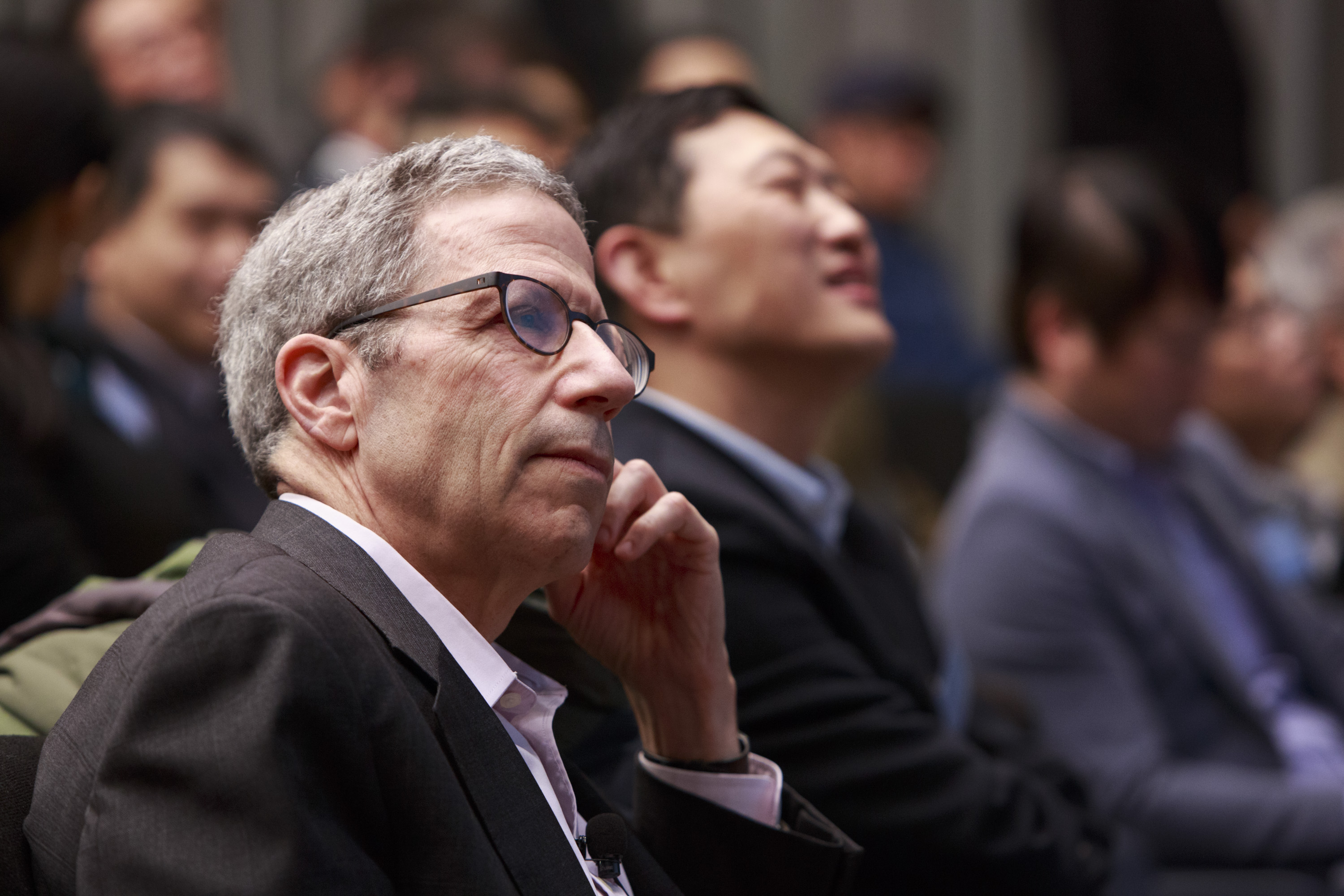 Professor Eric Maskin listens to the Welcome Remarks and Introduction delivered by Professor Chenggang Xu.