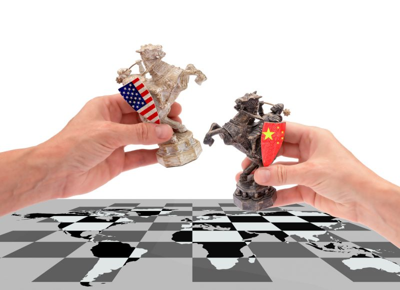 How do Chinese companies overcome challenges for global expansion
